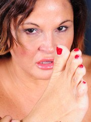 Playful mature fatty Stephanie licks her sexy toes and shows her feet and twat