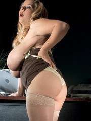 Fat secretary Sunshine whips out her giant tits wearing tan stockings