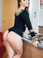 Euro model Amirah Adara does a slow striptease to get naked in kitchen