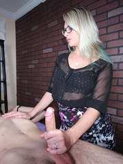 Clothed blond Vicky Vixxx ball gags and blindfolds man before jacking his dick