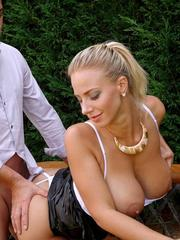 Big titted Euro chick Nathaly Cherie and a man take turns peeing on each other