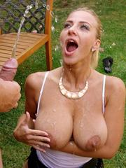 Busty female Nathaly Cherie and her kinky guy friend engage in water sports