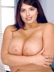 Big boobed MILF Kerry Marie teases her nipples before revealing her pussy