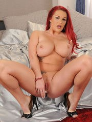 Chubby redhead Paige Delight bares her large tits before fun with a vibrator