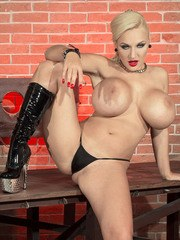 Chubby blonde Dolly Fox frees huge tits from latex dress on way to nude posing