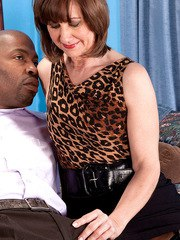 Top mature secretary gets black male to fuck her in the pussy and ass