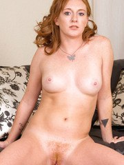 Freckled redhead amateur Gia Tyler peels off blue jeans on way to posing nude