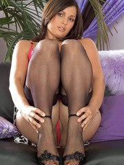 Solo model Maxine spreads her nylon clad legs to display her naked pussy