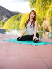 Natural redhead Gwen Stark removes spandex pants to pose nude after doing yoga