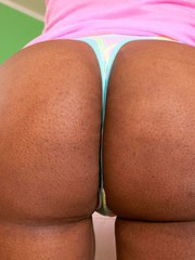 Ebony solo model Paris Sweetz works lotion into her round and brown booty