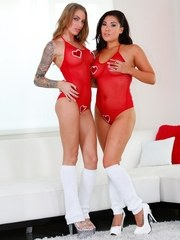 Lesbians Juelz Ventura  London Keyes peel off red swimsuits together