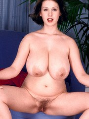 Euro model Nicole Peters fondles her knockers before toying her hairy bush