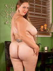 Obese female Analee Sands rocks her hooters and big butt while undressing