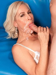 Hot mature blonde Carrie Romano bangs a younger guys big cock