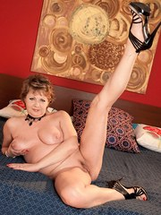 Middle-aged broad Donna Marie gingerly removes dress and black lingerie