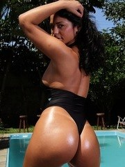 Sultry Latina vixen Diana Lins oils up herself playing a solo on the poolside