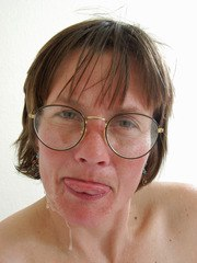 Nerdy amateur MILF in glasses stuffs her filthy mouth with a black pecker