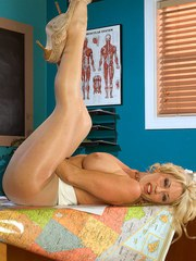 Older blonde Jenna Lynn parts her crotchless hose covered legs for pussy play