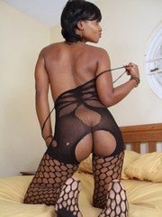 Ebony amateur in fancy pantyhose stretches pussy reveals her pink inner beauty