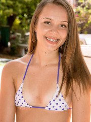Amateur girl with lovely tanlines Liza Rowe plays a solo on the poolside