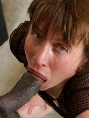 Ugly amateur slut fills her filthy mouth with a huge black wang and eats jizz