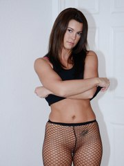 MILF in fishnet pantyhose Emily Briar plays an erotic solo showing her hot ass