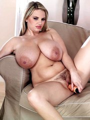 Blonde Kelly Kay shakes the big boobs and plays with the pussy in hot solo