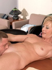 Middle-aged woman Chanel Carrera seduces a younger man for sex at work