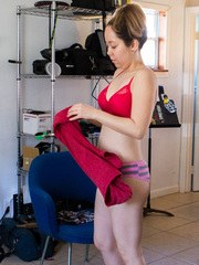 Nude amateur Felicia gets dressed on hidden camera in her apartment