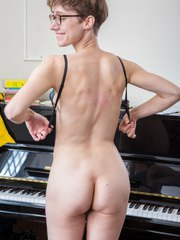 Thin amateur with short hair shows off her beaver on piano bench