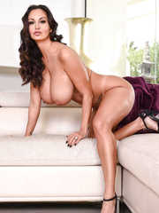Luscious housewife Ava Addams strips on a white sofa showing huge boobs