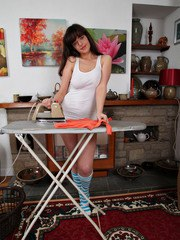 Brunette MILF with a sappy body spreads legs and stretches her narrow holes