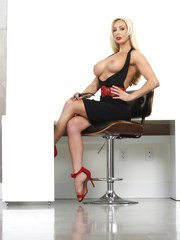 Blonde boss lady Olivia Fox shows off her round boobs in teh nude