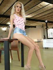 Leggy blonde female Monique Woods removes jeans shorts from her tight ass