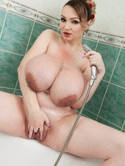 Amazing BBW babe Micky Bells soaps and foams her enormous boobs in the bath