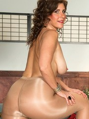 Mature BBW chick drills pussy with a toy through a hole in her pantyhose