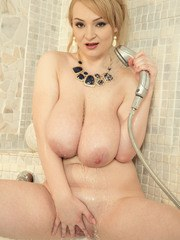 Eye-catching babe with big boobs Micky Bells shows her busty body in a shower