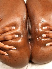 Ebony BBW bitch Aaliyah Envy shows off her oiled up chocolate body