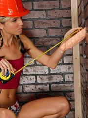 Gina Gerson finds a cock sticking thru gloryhole while doing home renovations