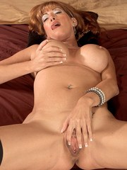 Mature seductress Rachel Rivers stripping and relaxing in bed with legs spread