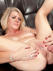 Crazy blonde mom Kay DeLynn unbuttons the guys jeans to deal with his dick