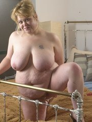 Lexus shows off her big tits and fatty ass while working a dildo in her pussy