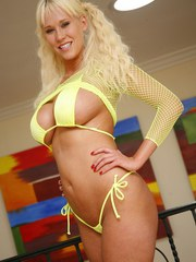Platinum blonde nymph Carly Parker reveals her fantastic body with fake jugs