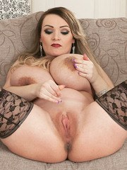 Buxom BBW hottie Micky Bells shows off her massive bubbles and a pink snatch