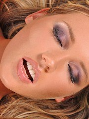 Cute lesbian sex dolls Electra Angel and Cherry Jul give each other some oral