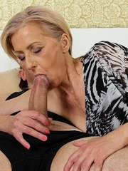 Granny worships a big cock and sucks it to get a portion of jizz on her face
