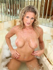 Jade shows off her nude forms in soapy scenes of premium MILF solo