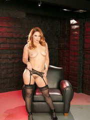Hot solo girl Edyn Blair peels off her satin bra and black panties on a chair