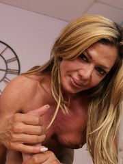 Awesome mature bodybuilder Nina Dolci gives an intense handjob to her dude