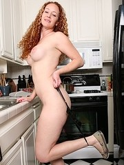 Older redhead housewife Kitty Caulfield strips naked after doing the dishes
